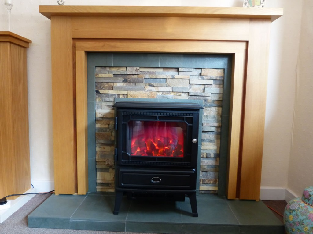 Valor dimension in an oak mantle with stone interior