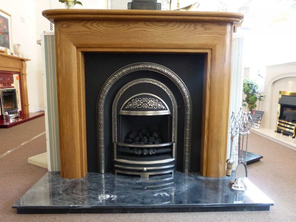High efficiency arch gas fire with oak mantle