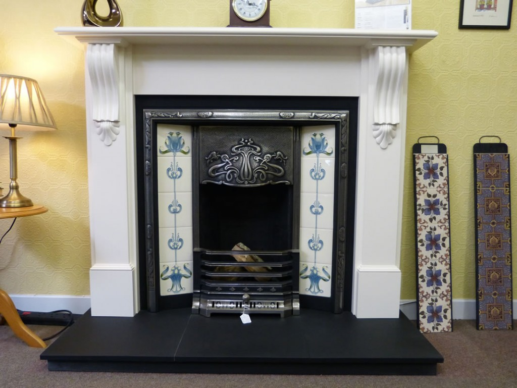 Traditional cast iron fireplace with a white corbel mantle