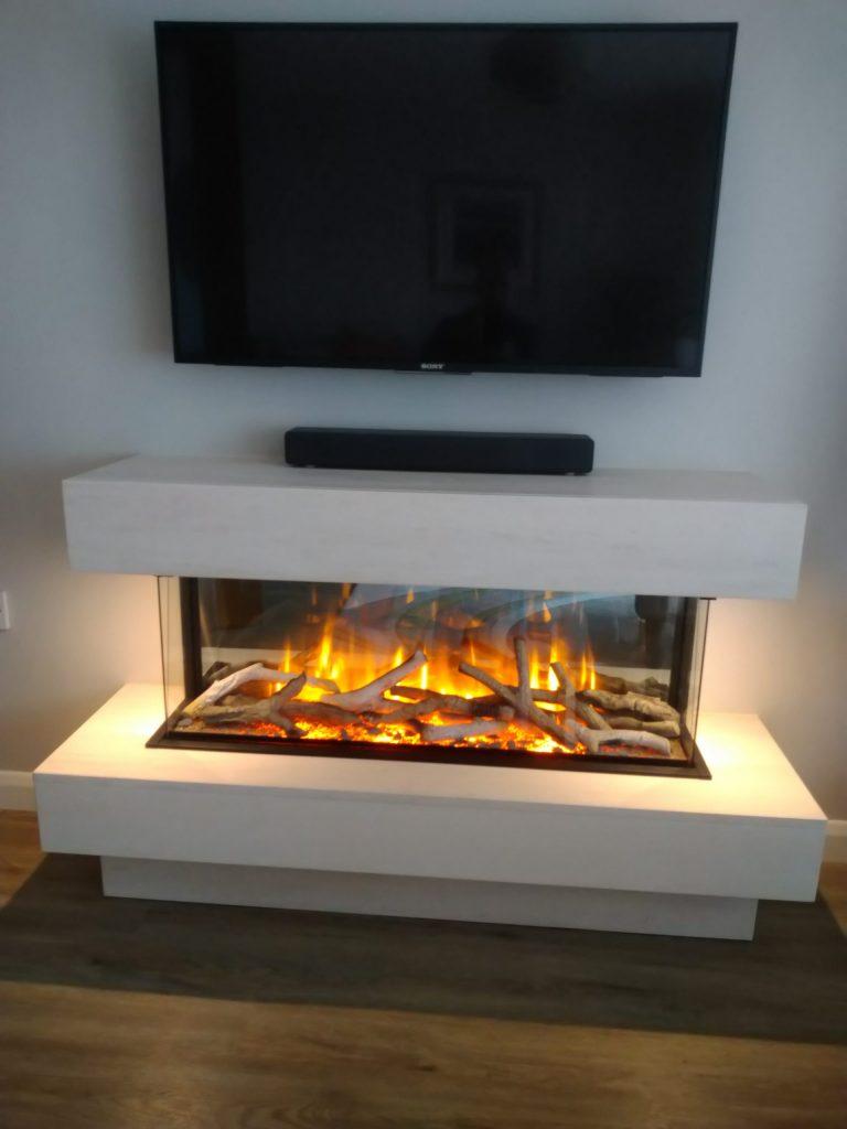 GLAZIER 1000 ELECTRIC FIRE IN LIMESTONE FIREPLACE